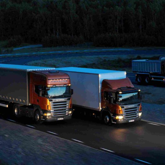 http://www.gisans.it/wp-content/uploads/Three-orange-Scania-trucks-540x540.jpg